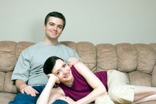 A Woman Lying On A Man S Lap Sitting On Sofa Stock Photography