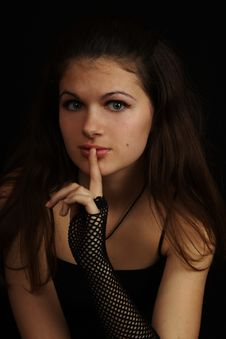 Free Young Girl With A Finger Near The Lips Royalty Free Stock Photos - 5482748