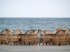 Rattan Chairs Bar Empty On Beach Stock Images