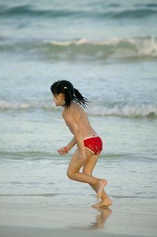 Free Child Running In The Sand Stock Photography - 5483082