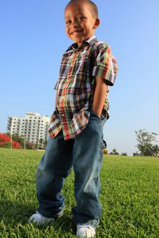 Free Young Boy Posing On The Grass Royalty Free Stock Photography - 5489347