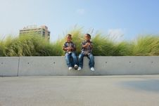 Free Two Boys Sitting On A Ledge Stock Photography - 5489372