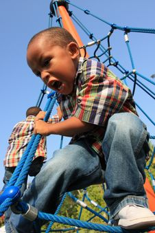 Free Boy On A Playground Stock Image - 5489401