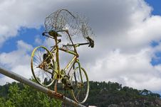 Old Bicycle Placed On A Suspension Bridge