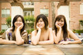 Free Three Girls Relaxing Outdoor Royalty Free Stock Photography - 5493147