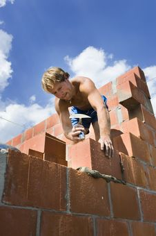 Free Construction Worker Building A Wall Stock Image - 5491671