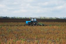 Free Tractor In Field Stock Image - 5491911