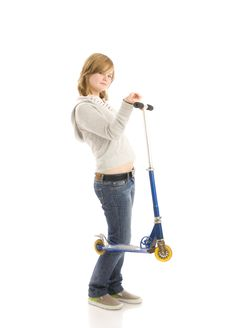 Free The Young Beautiful Girl With A Scooter Royalty Free Stock Image - 5494646