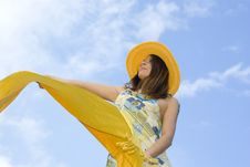 Free Young Woman Holding Orange Wrap Against Blue Sky Royalty Free Stock Photo - 5495135
