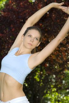 Free Sporty Girl Exercising On Meadow Against The Sky Royalty Free Stock Images - 5495439