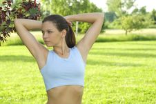 Free Sporty Girl Exercising On Meadow Against The Sky Stock Photo - 5495530
