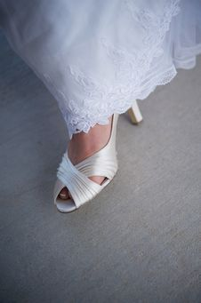 Free Bride S Formal Shoe Showing From Underneath Gown Stock Photography - 5497972