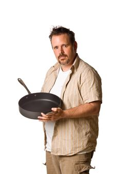 Free Man Holding Frying Pan Royalty Free Stock Photography - 5498987