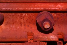 Free Rusted Bolt On Rails Stock Photo - 558400
