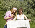 Free Two Beautiful Girls Look At The Map Stock Images - 5508014