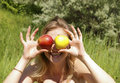 Free Woman Holding Up Two Apples Royalty Free Stock Image - 5508106