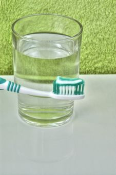 Free Dental Brush And Glass Of Water Stock Image - 5502451