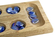 Free Wooden Mancala Game With Blue Stones Stock Photography - 5503512