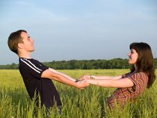 Free Teen Couple Holding Hands Field Royalty Free Stock Photos - 5503568