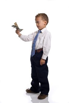 Free Young Boy Dressed As Businessman Holds Money Stock Photography - 5505402