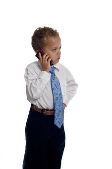 Young Boy Dressed As Businessman Uses Cell Phone