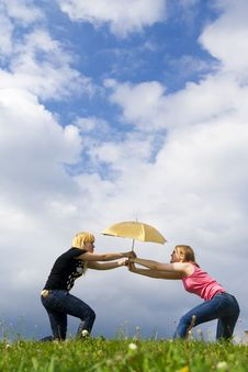 Free The Two Young Attractive Girls With A Umbrella Stock Image - 5507271