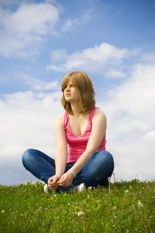 Free The Young Girl Sitting On A Green Grass Stock Image - 5507301
