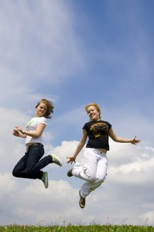 Free The Two Happy Jumping Girls Royalty Free Stock Photo - 5507455