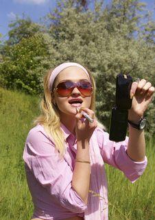Free Beautiful Woman Applying Pink Lipstick Royalty Free Stock Photos - 5507798