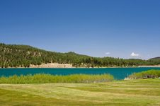 Free An Image Of A Aqua Lake Near A Golf Hole Stock Photography - 5508492