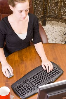 Free Woman Working On PC Keyboard And Mouse. Royalty Free Stock Photography - 5508577