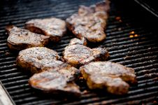 Free Juicy Pork Chops On A Grill Royalty Free Stock Image - 5508826