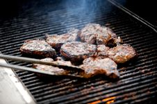 Free Juicy Pork Chops On A Grill Royalty Free Stock Images - 5508839