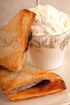 Free Blueberry Turnovers With Fresh Whipped Cream Stock Photos - 5508943