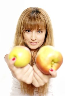 Free Beautiful Young Woman Looking At Apples. Royalty Free Stock Photos - 5509018