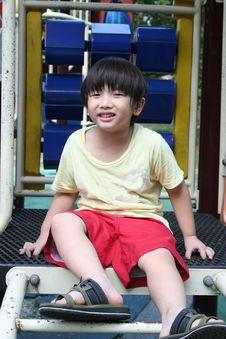 Free Boy Sitting On The Sllide Stock Photo - 5509330