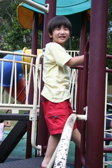 Free Boy Standing On The Slide Stock Photo - 5509370