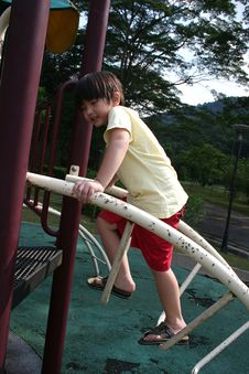 Free Boy Climbing Up Slide Royalty Free Stock Photography - 5509437