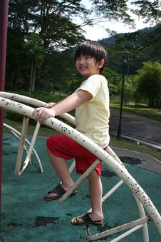 Free Boy Climbing Up Slide Royalty Free Stock Photography - 5509467