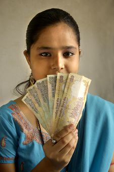 Free A Woman Holding Currency. Stock Image - 5509621