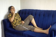 Free A Woman In A Blue Sofa. Royalty Free Stock Photography - 5509657