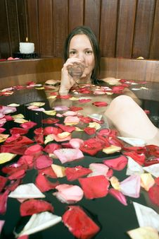 Free Woman Drinking Water In Tub - Vertical Stock Photography - 5509682