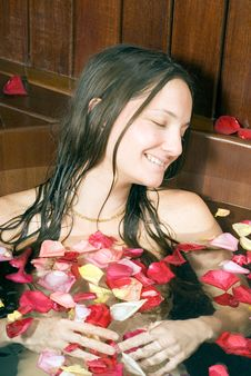 Free Woman Smiles And Relaxes In Tub - Vertical Stock Image - 5509921