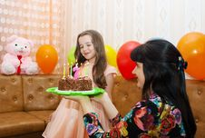 Free Mom Gives Daughter A Birthday Cake Stock Photography - 55065682