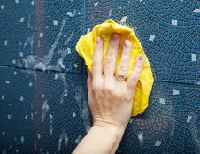 Free Female Hand Washes Tihe Tile On The Wall Stock Photography - 55069272