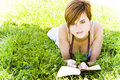 Free Blonde Reading At Park Royalty Free Stock Photography - 5517477