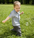 Free The Kid Running On A Meadow Stock Photos - 5518223