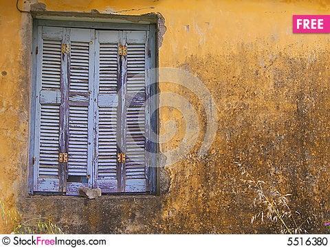 Free Blue Window Shuttered On Yellow Wall. Stock Photo - 5516380