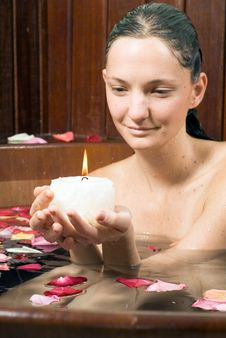 Free Woman In Tub With A Candle - Vertical Royalty Free Stock Image - 5510096