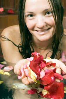 Free Smiling Woman Bathing In Flowers - Vertical Stock Images - 5510174